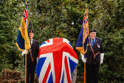 Event Photography Image: The Godmanchester Stirling Memorial Stone Dedication Ceremony Cow Lane Saturday 9th September 2017 in memory of the crew of Short Stirling Mk1 N3703 which crashed 11th April 1942 after being unable to land at RAF Alconbury following publication of Stirling to Essen:  A Bomber Command Story of Courage and Tragedy by Roger Leivers  (#6: Two Ex RAF Servicemen with Royal British Legion Standards guard the Memorial Stone). © bokeh photographic (Alistair Grant): Freelance Photographer, St Ives, Cambridge.
