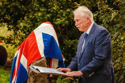 Event Photography Image: The Godmanchester Stirling Memorial Stone Dedication Ceremony Cow Lane Saturday 9th September 2017 in memory of the crew of Short Stirling Mk1 N3703 which crashed 11th April 1942 after being unable to land at RAF Alconbury following publication of Stirling to Essen:  A Bomber Command Story of Courage and Tragedy by Roger Leivers  (#2: Roger Leivers addresses the crowd). © bokeh photographic (Alistair Grant): Freelance Photographer, St Ives, Cambridge.
