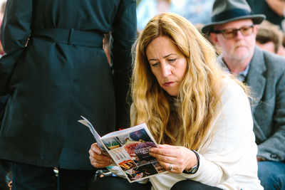 2017 Aldeburgh Food & Drink Festival: Festival Attendee studying the Programme.   bokeh photographic - Alistair Grant.