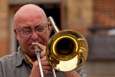 Trombonist. © bokeh photographic (Alistair Grant): Professional Photographer: Cambridgeshire, Bedfordshire, Northamptonshire, Norfolk, Suffolk, Essex & Hertfordshire.