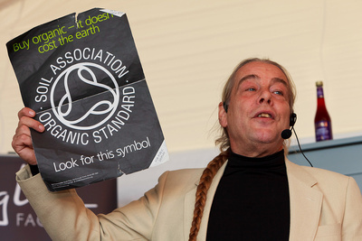 Food Photography Portfolio – Bob Flowerdew holding up a Soil Association Organic Standard poster. © bokeh photographic (Alistair Grant): Food Photographer, St Ives, Cambridge.