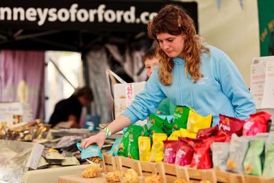 Food Photography Portfolio – Aldeburgh Food Festival Exhibitor arranging produce. © bokeh photographic (Alistair Grant): Food Photographer, St Ives, Cambridge.