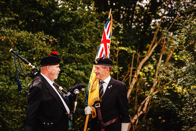 Event Photography Image: The Godmanchester Stirling Memorial Stone Dedication Ceremony Cow Lane Saturday 9th September 2017 in memory of the crew of Short Stirling Mk1 N3703 which crashed 11th April 1942 after being unable to land at RAF Alconbury following publication of Stirling to Essen:  A Bomber Command Story of Courage and Tragedy by Roger Leivers  (#5: Piper Ross Kebble chats to an Ex RAF Serviceman). © bokeh photographic (Alistair Grant): Freelance Photographer, St Ives, Cambridge.