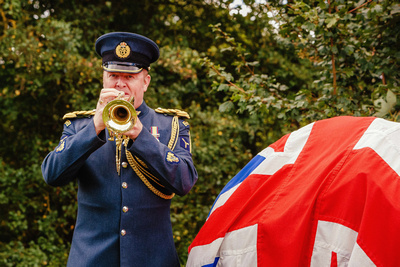 Event Photography Image: The Godmanchester Stirling Memorial Stone Dedication Ceremony Cow Lane Saturday 9th September 2017 in memory of the crew of Short Stirling Mk1 N3703 which crashed 11th April 1942 after being unable to land at RAF Alconbury following publication of Stirling to Essen:  A Bomber Command Story of Courage and Tragedy by Roger Leivers  (#4: An RAF trumpeter plays the Last Post in front of the Memorial Stone). © bokeh photographic (Alistair Grant): Freelance Photographer, St Ives, Cambridge.