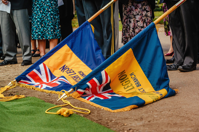 Event Photography Image: The Godmanchester Stirling Memorial Stone Dedication Ceremony Cow Lane Saturday 9th September 2017 in memory of the crew of Short Stirling Mk1 N3703 which crashed 11th April 1942 after being unable to land at RAF Alconbury following publication of Stirling to Essen:  A Bomber Command Story of Courage and Tragedy by Roger Leivers  (#10: Lowered Royal British Legion Standards). © bokeh photographic (Alistair Grant): Freelance Photographer, St Ives, Cambridge.