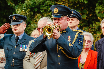 Event Photography Image: The Godmanchester Stirling Memorial Stone Dedication Ceremony Cow Lane Saturday 9th September 2017 in memory of the crew of Short Stirling Mk1 N3703 which crashed 11th April 1942 after being unable to land at RAF Alconbury following publication of Stirling to Essen:  A Bomber Command Story of Courage and Tragedy by Roger Leivers  (#9: An RAF trumpeter plays the Last Post). © bokeh photographic (Alistair Grant): Freelance Photographer, St Ives, Cambridge.