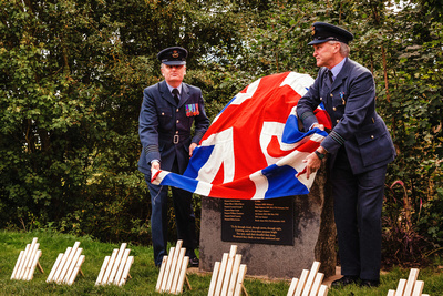 Event Photography Image: The Godmanchester Stirling Memorial Stone Dedication Ceremony Cow Lane Saturday 9th September 2017 in memory of the crew of Short Stirling Mk1 N3703 which crashed 11th April 1942 after being unable to land at RAF Alconbury following publication of Stirling to Essen:  A Bomber Command Story of Courage and Tragedy by Roger Leivers  (#7: Wing Commander Phil Owen of RAF Wyton and Squadron Leader Clive Wood of RAF Alconbury unveil the Memorial Stone). © bokeh photographic (Alistair Grant): Freelance Photographer, St Ives, Cambridge.