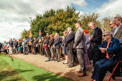 Event Photography Image: The Godmanchester Stirling Memorial Stone Dedication Ceremony Cow Lane Saturday 9th September 2017 in memory of the crew of Short Stirling Mk1 N3703 which crashed 11th April 1942 after being unable to land at RAF Alconbury following publication of Stirling to Essen:  A Bomber Command Story of Courage and Tragedy by Roger Leivers  (#8: Dignitaries and guests pay their respects). © bokeh photographic (Alistair Grant): Freelance Photographer, St Ives, Cambridge.