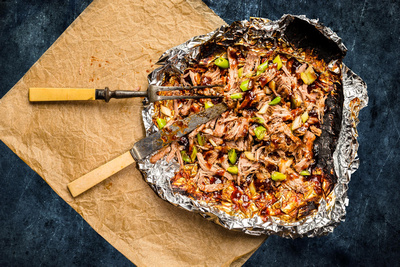 Food & Drink Photography Image of BBQ Pulled Pork in a Hickory Marinade in foil with meat fork and knife. © bokeh photographic (Alistair Grant): Food Photographer, St Ives, Cambridge.