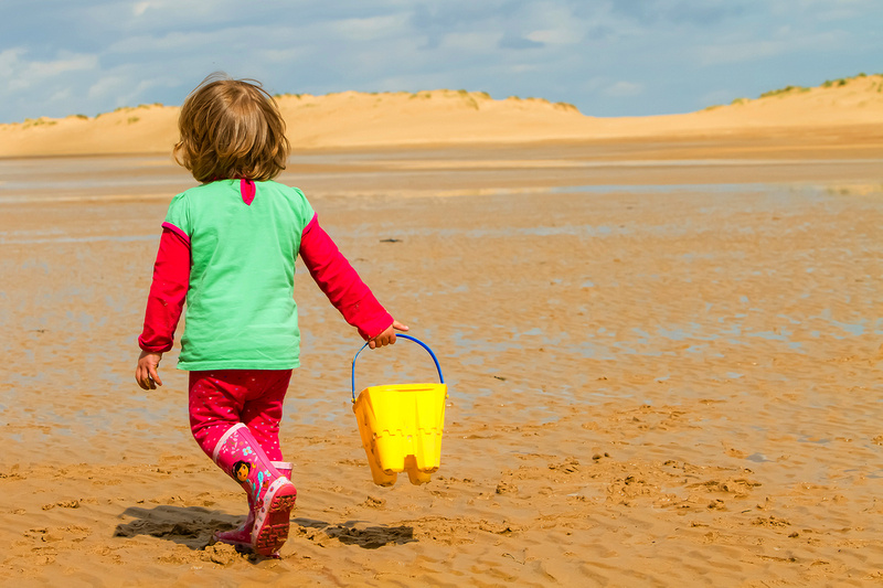 Freelance Photographer Cambridge Blog Image | Blog 16 - Young girl with bucket on an Active Portraiture photo-shoot at Holkham Beach. © bokeh photographic (Alistair Grant): Freelance Photographer, St Ives, Cambridge, London and across the UK.